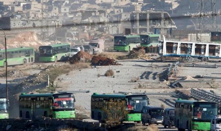تعليق عمليات إجلاء المسلحين وعائلاتهم من شرق حلب جراء اخلالهم بالاتفاق